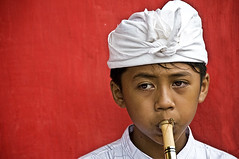 Ubud, Bali - Portrait of a young Flute Player on Kuningan Day (Mio Cade) Tags: road street travel boy bali music motion boys beautiful festival kids children indonesia photography kid outfit interesting asia child walk flute newyear musical instrument perform southeast performer celebrate kuningan barong balinese galungan