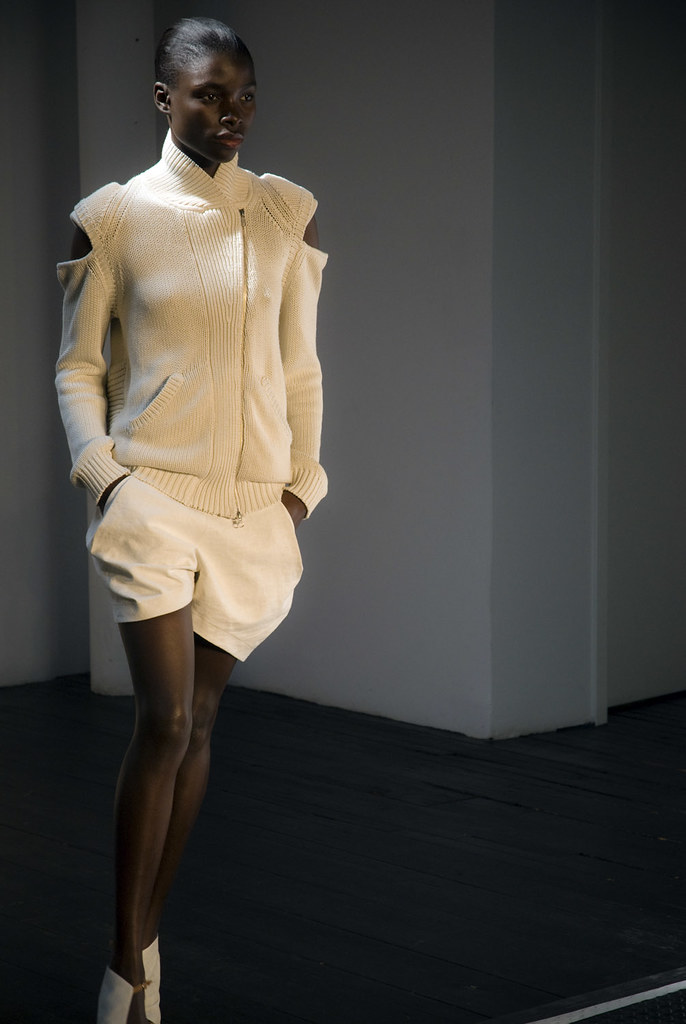 Model wearing white knit outfit on runway at Fashion Week Show, NY