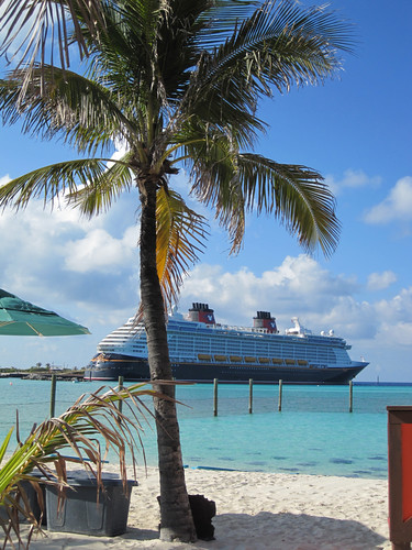 The Disney Dream docked at Castaway Cay, you can see the stingrays in the water.