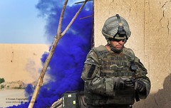 Soldier Awaits Helicopter Landing During Operation Omid Haft in Afghanistan (Defence Images) Tags: uk blue afghanistan soldier army military smoke british op operation campaign defense defence personnel lashkargah identifiable helmandprovince omidhaft