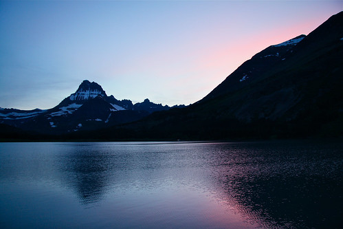 Sunset at Swiftcurrent Lake by alumroot