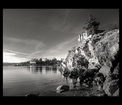 House on a Cliff (ecstaticist) Tags: ocean sunset bw sun white house canada black west tree beach rock canon waves bc conversion victoria pointe outcropping saxe photomatix tonemapped tonemapping g10 pseudohdr superciaomyfriend