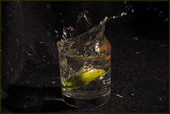A Little Lime With Your Gin And Tonic? (Zircon_215) Tags: glass darkroom splash gin bulbsetting tonicwater limewedge vivitar283flash nikond300 wateractually