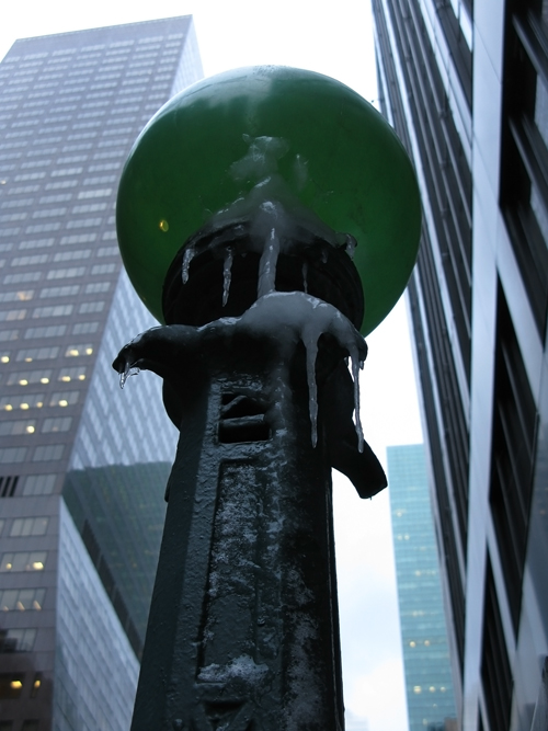 icicles hang on a subway ball, midtown Manhattan, NYC