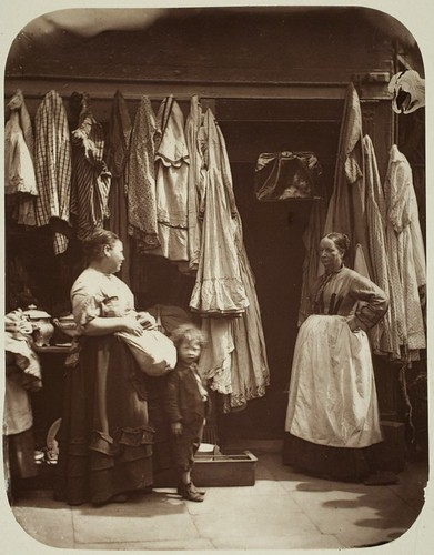 An Old Clothes' Shop, Seven Dials. by George Eastman House.