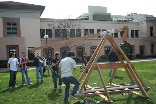 ASME Students launching trebuchet they built during National Engineering Week 2009