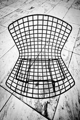 Sit right down (justingreen19) Tags: nyc bw sculpture usa white newyork black art sunshine metal museum modern america outside grid grey chair noir floor outdoor manhattan seat curves gray sigma moma 1020mm blanc sculpturegardens linesandcurves momasculpturegarden museumofmodenart