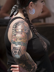 tattooed (Bill Oriani) Tags: street girl festival tattoo austin photography bill texas pecan 2009 6th oriani 50200mmf2835 olympuse3 billoriani