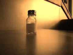 Bronze Salt Shaker on Table