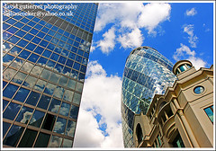 London ~ Blue Glass in the Sky ~ (david gutierrez [ www.davidgutierrez.co.uk ]) Tags: city blue sky urban building london tower architecture clouds skyscraper buildings spectacular geotagged photography photo arquitectura cityscape image sony centre perspective cities cityscapes center structure architectural foster 350 londres architektur sensational metropolis alpha topf100 gherkin londra impressive 30stmaryaxe dt aviva municipality edifice cites f4556 100faves 1118mm mywinners aplusphoto theunforgettablepictures platinumheartaward sonyalphadt1118mmf4556lens sonyalphadt1118mmf4556 sony350dslra350