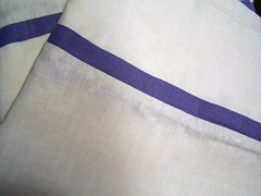 white with lavender pillowcases