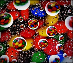 DROPLET REFLECTIONS (Darren Speak) Tags: macro canon sweets mm coloured compact ithinktheyareyouknow arentmmsjustlikesmarties
