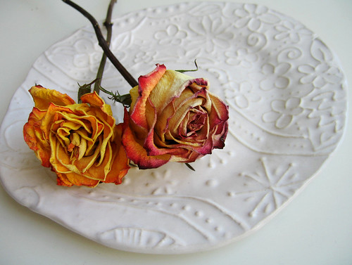 Dried roses on a plate