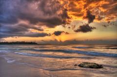 first light (richietown) Tags: ocean light topf25 colors topv111 rock clouds sunrise canon topv333 waves horizon beams hdr 30d cs3 sigma1020mm 3xp photomatix 3exp richietown