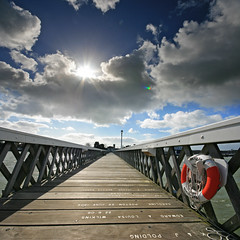 UFO (unidentified flare object) over Yarmouth Pier, Isle of Wight, UK (s0ulsurfing) Tags: wood uk travel blue shadow england sky cloud sunlight holiday tourism clouds composition contrast canon square island march pier photo vanishingpoint wooden holidays flickr skies shadows lifebelt britain pov sightseeing wide perspective fluffy wideangle tourist ufo aliens pointofview filter photograph isleofwight cumulus flare rays yarmouth sunrays grad isle shafts 2009 beams diffused squared sights lifesaver wight attraction sunbeams westwight 10mm leadinglines sigma1020 nd4 s0ulsurfing visitorattraction fivestarsgallery aplusphoto vertorama isleofwightattractions isleofwightattraction