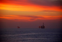 platforms in the evening (jst images) Tags: ocean california sunset water night clouds waves oil oc huntingtonbeach hb oilplatform colorphotoaward