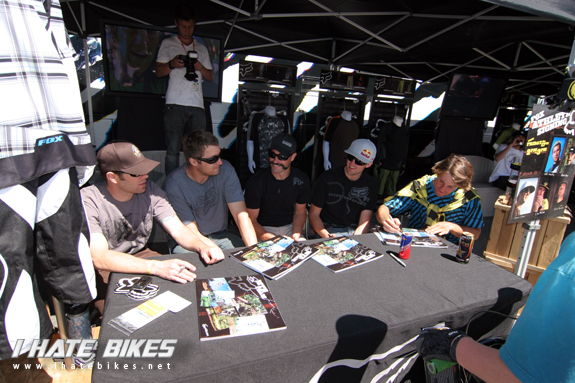 the Fox Racing Team lines up for an autograph session with their fans.