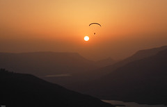 flying off to the sun ([s e l v i n]) Tags: sunset sky sun india mountains freedom fly flying flight free paragliding panchgani soaring glide parafly paraflying selvin flyingtothesun best2009
