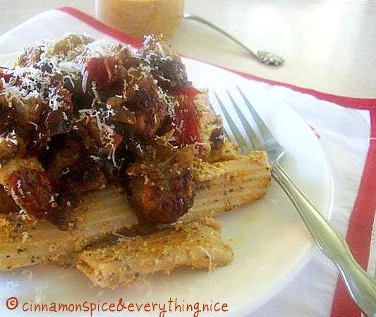 Pasta w/ Tomato Pesto  Caramelized Peppers & Sausage Pasta w/ Tomato Pesto