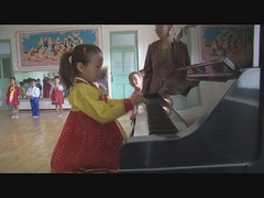 North Korean girl playing The Internationale - DPRK (Eric Lafforgue) Tags: school girl video play propaganda sony piano communist socialist hd joue ecole internationale northkorea dprk z7 linternationale theinternationale chongsanri kimjongun lacra socialdemocraticanarchistanthem