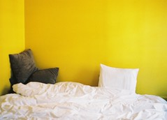 superbed (Sarah__McLean) Tags: paris yellow wall 35mm canon eos bed away sheets 2009