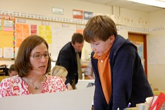 Article image: Shelly Moody works with a student on his project during Commissioner Stephen Bowen's visit to her classroom on May 10, 2011.