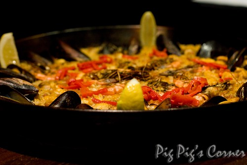 A Spanish classic - Paella Rice cooked with prawns, squid, mussels and vegetables