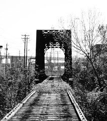 Through Truss Railroad Bridge, Buffalo Bayou, Downtown Houston, Texas 0319091038BW (Patrick Feller) Tags: downtown houston texas decay neglect bridge railroad railway through truss train abandoned steel structural structure rivets converging vanishing point blackandwhite black white bw blackwhite cmwd cmwdblackandwhite disused rightofway row grade pontist united states north america