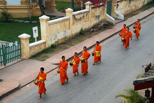 monks going for morning alms, luang prabang