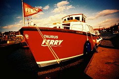 Taurus Ferry. (Trapac) Tags: uk red england film ferry bristol boats boat spring xpro crossprocessed cabin fuji waterfront floating rope flags slidefilm plasticfantastic bow 100 publictransport ra taurus vivi vivitar find harbourside plasticcamera boatyard sensia moorings moored 100iso fujisensia wmh underfallyard vivitarultrawideslim vivitarultrawideandslim fujira bristolcitycouncil peakimaging vivitarws vivitarroll28 taurusferry processedscannedbypeakimagingsheffield theunderfallyard