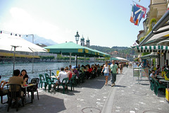 Cafes Along Lake Lucern (cwgoodroe) Tags: sun mountain lake snow alps green church statue ferry fairytale swimming switzerland boat europe locals suisse swiss sunny location farms movieset luce swissalps lucern medivil beerpasture