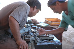 Mechanics repairing an engine, San Rosalia, Ba...