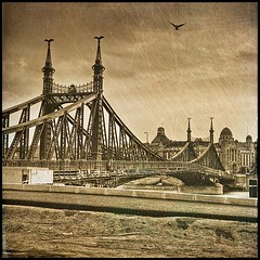 I wear the bridges in the family (PhatCamper) Tags: camera sunset building texture water monochrome sepia architecture vintage buildings river spring flickr hungary cityscape metallic text budapest naturallight textures filter oriental duna filters ungarn danube donau hungarian irfanview magyarorszg freedombridge hongrie reinvented 500x500 libertybridge blueribbonwinner gellrthegy szabadsghd hotelgellert pseudohdr dunapart szpia donauradwanderweg singlerawtonemapped olymouse410 gellrtszll phatcamper lesbrumes sasokszrnyn iwearthebreeches