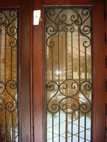 Custom Mahogany Wood Impact Doors With Wrought Iron Grills