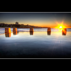 c o o g e e (Pawel Papis Photography) Tags: ocean morning blue beach water yellow photoshop sunrise concrete cs2 sydney australia shore nsw newsouthwales rays hdr tidalpool coogee coogeebeach smoothness 3xp photomatix sigma1020 goldish canon400d