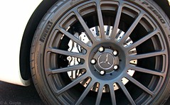 Mercedes Benz CLK63 Black Series (Monkey Wrench Media) Tags: black detail wheel silver emblem mercedes benz bs coat wheels nuts tire 63 chrome brakes series p brake nut disc zero mb discs amg lug clk pirelli lugs calipers drilled pzero powdercoat clk63
