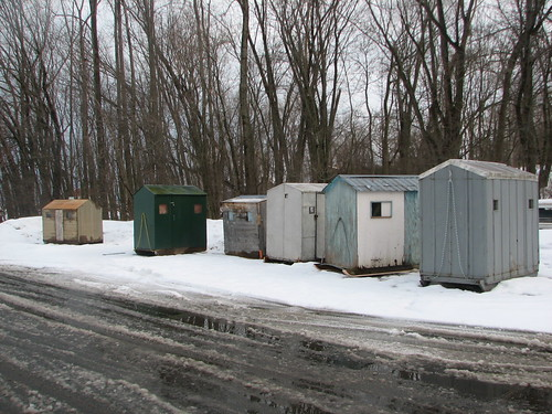 ice fishing shanties in the boat launch parking lot