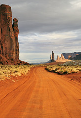 Following the path.... (TravelnFotog) Tags: travel arizona landscape nikon sandstone rocks scenic totempole navajo monumentvalley d300 travelnfotog