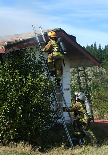Climbing a ladder - Fire training - fire fighter