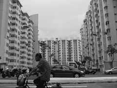 The Lion City (Trailer) (naveen p. m.) Tags: people bicycle blackwhite singapore streetphotography hdb singapura thirdtimelucky kyocerafinecamm410r thelioncity