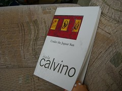 Under the Jaguar Sun by Calvino (traveling peter) Tags: red white germany munich toy bavaria book march pig europe couch indoors cover 2009 myapartment calvino bathtoy italocalvino 111v1f ismaning plasticpig pigsforfun peterspig watersquirt underthejaguarsun year2009 munichcounty
