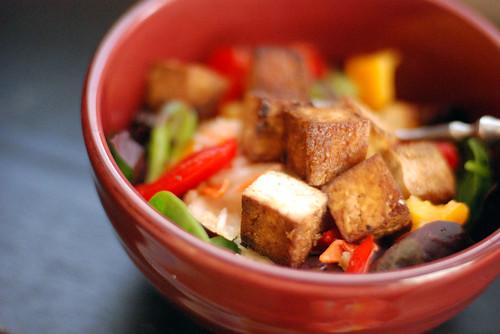 Sarahs Savory Baked Tofu over a tasty veggie salad.