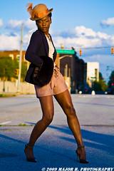 APG - Malika (BlazinBajan) Tags: bridge atlanta woman girl hat pose model pretty dof bokeh streetsign feather depthoffield jacket esp mbp apg malika elliottstreet elliottstreetpub majorbphotography apg042109