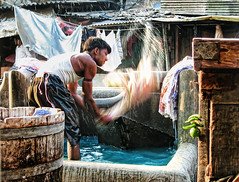 DHOBI ( Rizwan Mithawala) Tags: life india water work lemon interesting asia linen culture photojournalism documentary dirty clean textures wash national bombay tradition cloth custom mumbai tones saat rasta geographic chillies freelance photojournalist ghat worli mahalaxmi dhobi rizwan saatrasta washerman rizwanmithawala mithawala