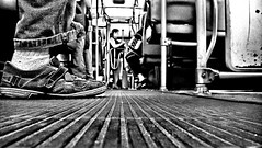 Passengers get on your boots (Jhows) Tags: people blackandwhite bw macro bus socks boot foot shoes iron dof floor sopaulo dirty nibus p sapato pinheiros catraca w120 jhonatas jhows passensers