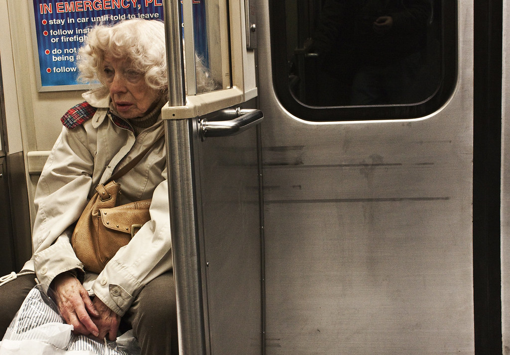 Old woman on subway