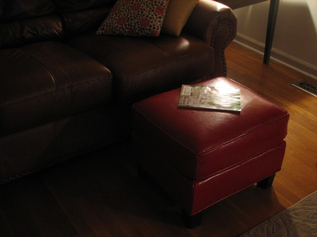 a favorite purchase: RED leather ottoman from pier 1