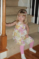 sitting on the stairs in her Easter dress