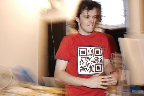Kratt wearing velcro QR code T-shirt