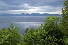 Lake Champlain and Adirondack Mountains New York State (jackie weisberg) Tags: usa cloud lake ny newyork nature water horizontal clouds landscape us essexcounty lakes photograph american newyorkstate picturesque nys lakechamplain adirondackmountains